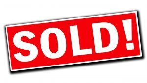 red & white Sold House for Fast Cash sign