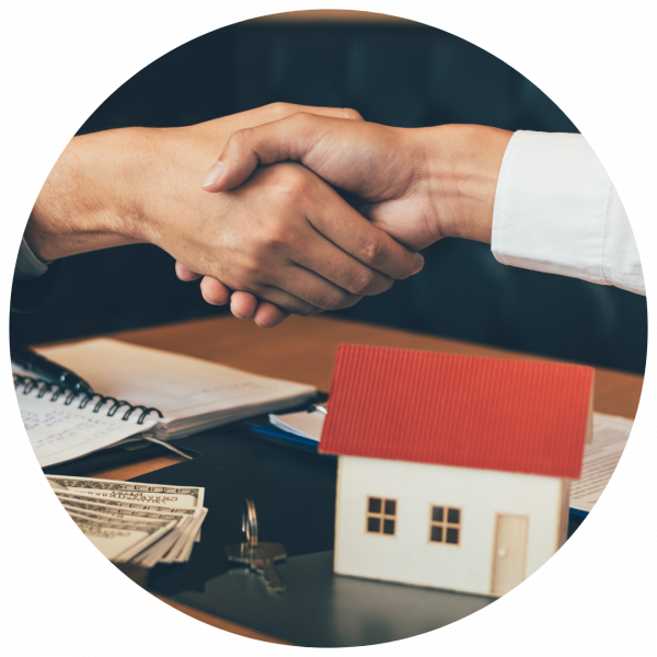 shaking hands after cash for house sale was completed