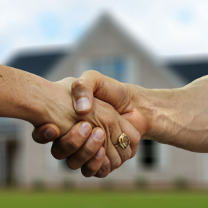 Men shaking hands upon sell my home fast