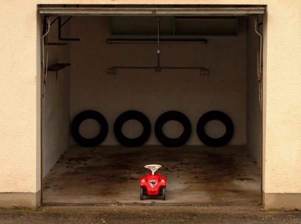 Image of garage with small toy car inside